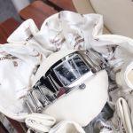 Tissot T-Classic T10 Polished Mặt Chữ Nhật Màu Đen Dây Kim Loại Màu Bạc T073.310.11.057.00