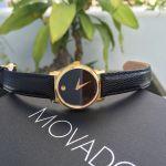 Movado Museum Mặt Tròn Viền Vàng Dây Da Màu Đen 2100006